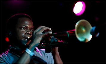 The trumpeter Ambrose Akinmusire playing with his quintet at Sullivan Hall, part of the sixth NYC Winter Jazzfest shows in Greenwich Village. Photo by Joe Kohen, NY Times in 2010.