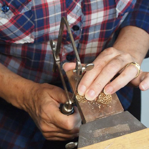 Sawing, drilling, burring, setting, and soldering are some of the activities done at a goldsmith's bench.
