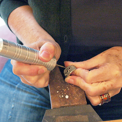 A foredom drill, powered by a foot pedal, is used to cut seats for diamonds or gemstones to be set in.