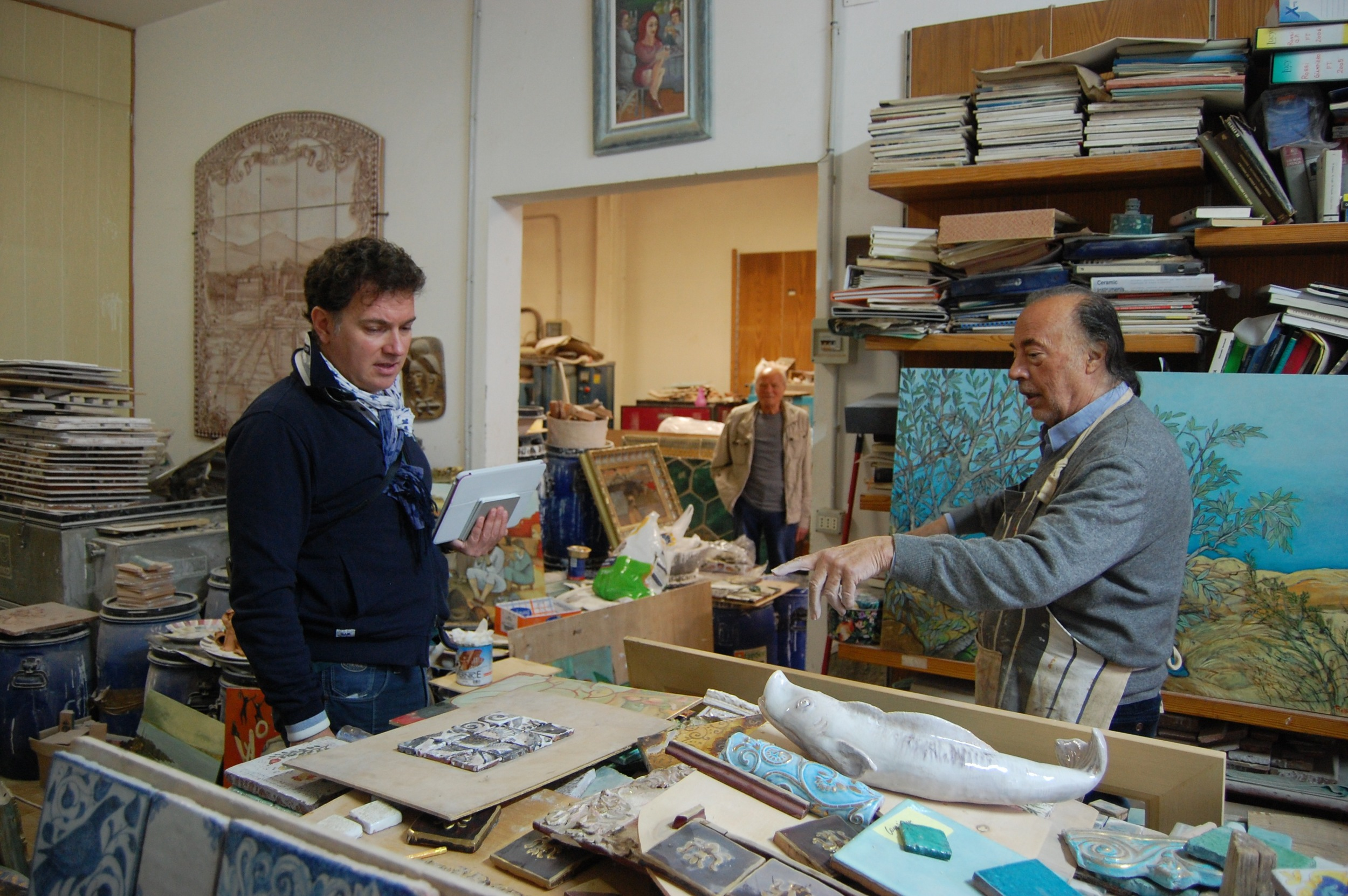 Gianpiero shows his work to Giorgio