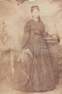 Young Caroline (Breese) Wood stands for a photograph.