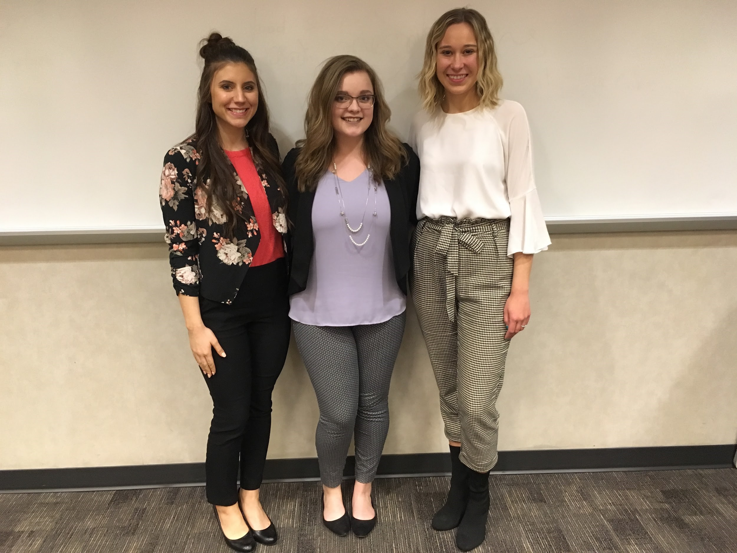 Kelsey Pardue, Adrienne Cooley, and Bri Olson of GrandPR modeling their professional looks at a recent meeting.