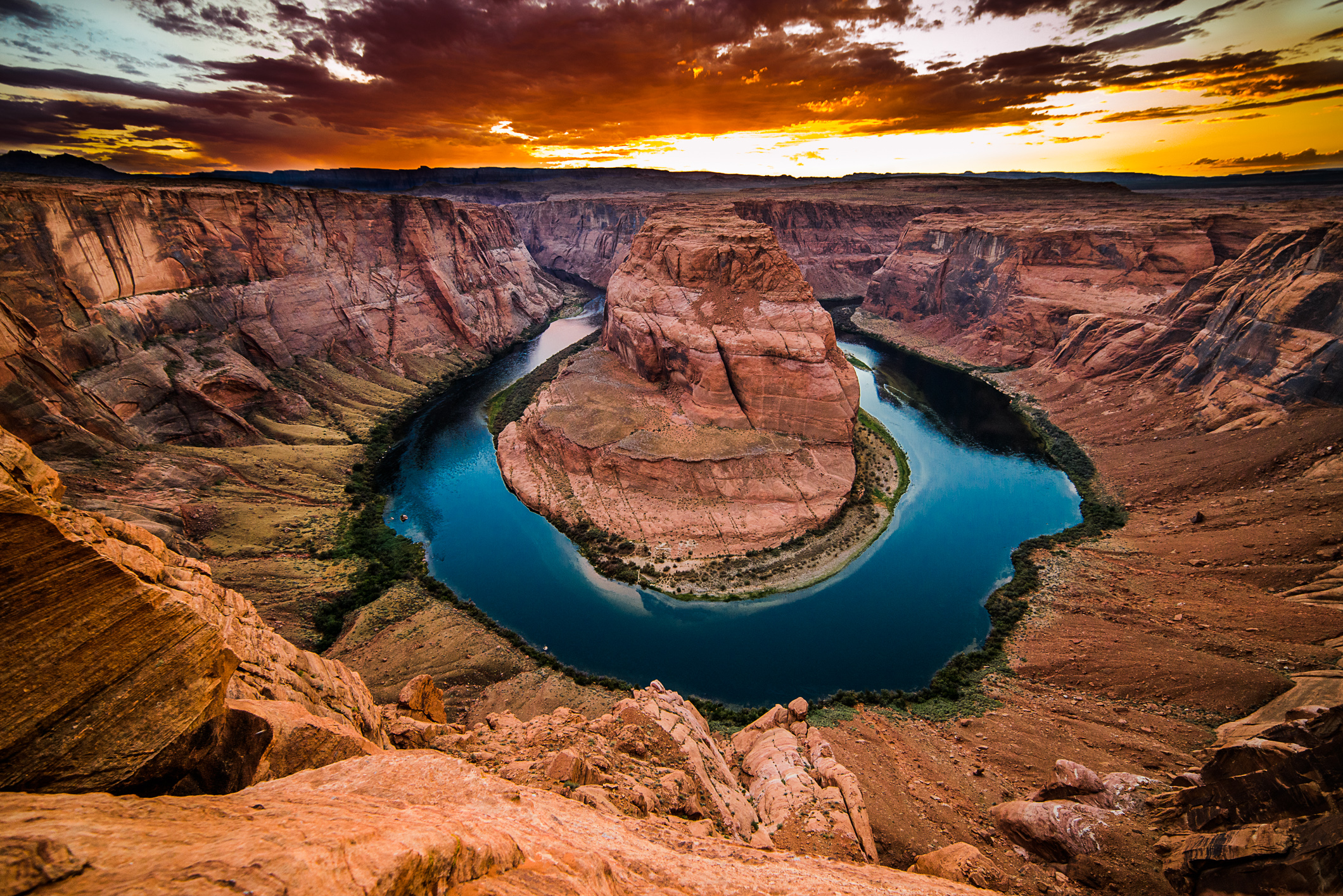 Weathering and erosion by the Colorado River carved this dramatic canyon out of the rock at Horseshoe Bend, in Arizona.