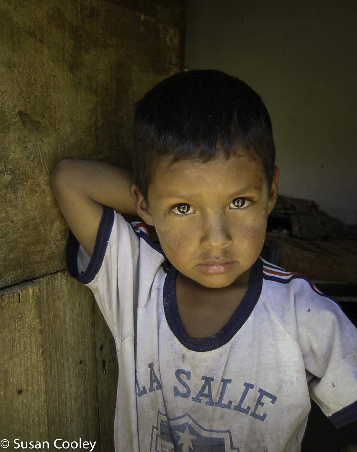 Bolivian Boy in the doorway.