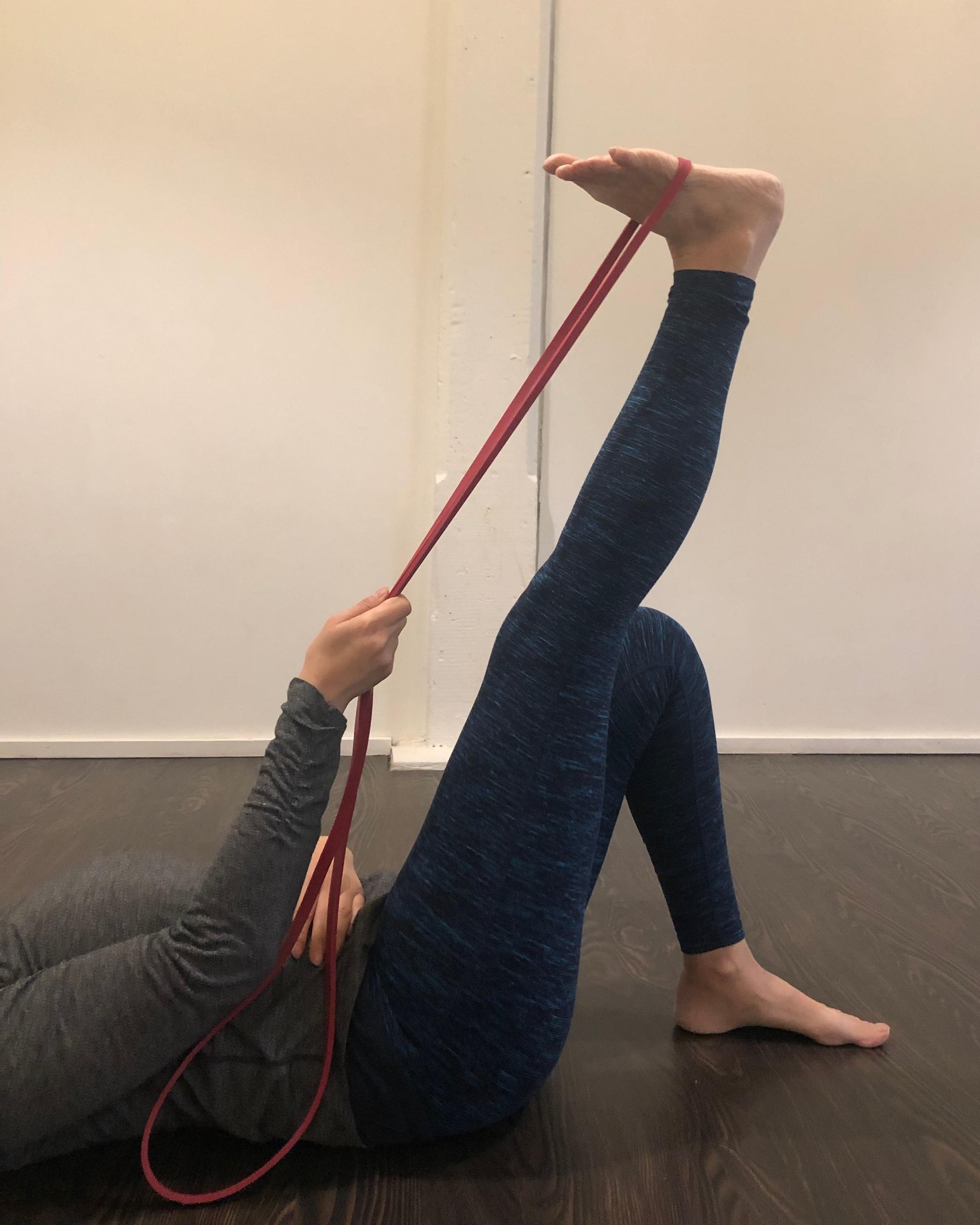 Hamstring stretch - Pilates at Amma Yoga in Kitchener