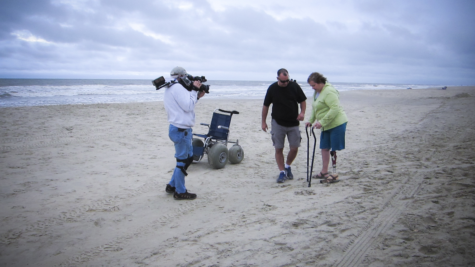 On the beach in North Carolina with Susan Donovan, witnessing her first steps on sand with her new prosthetic leg