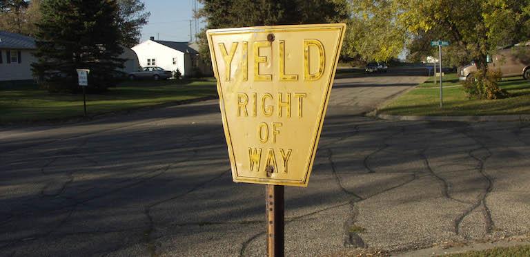 Old keystone-shaped yellow yield sign, Petersburg, North Dakota