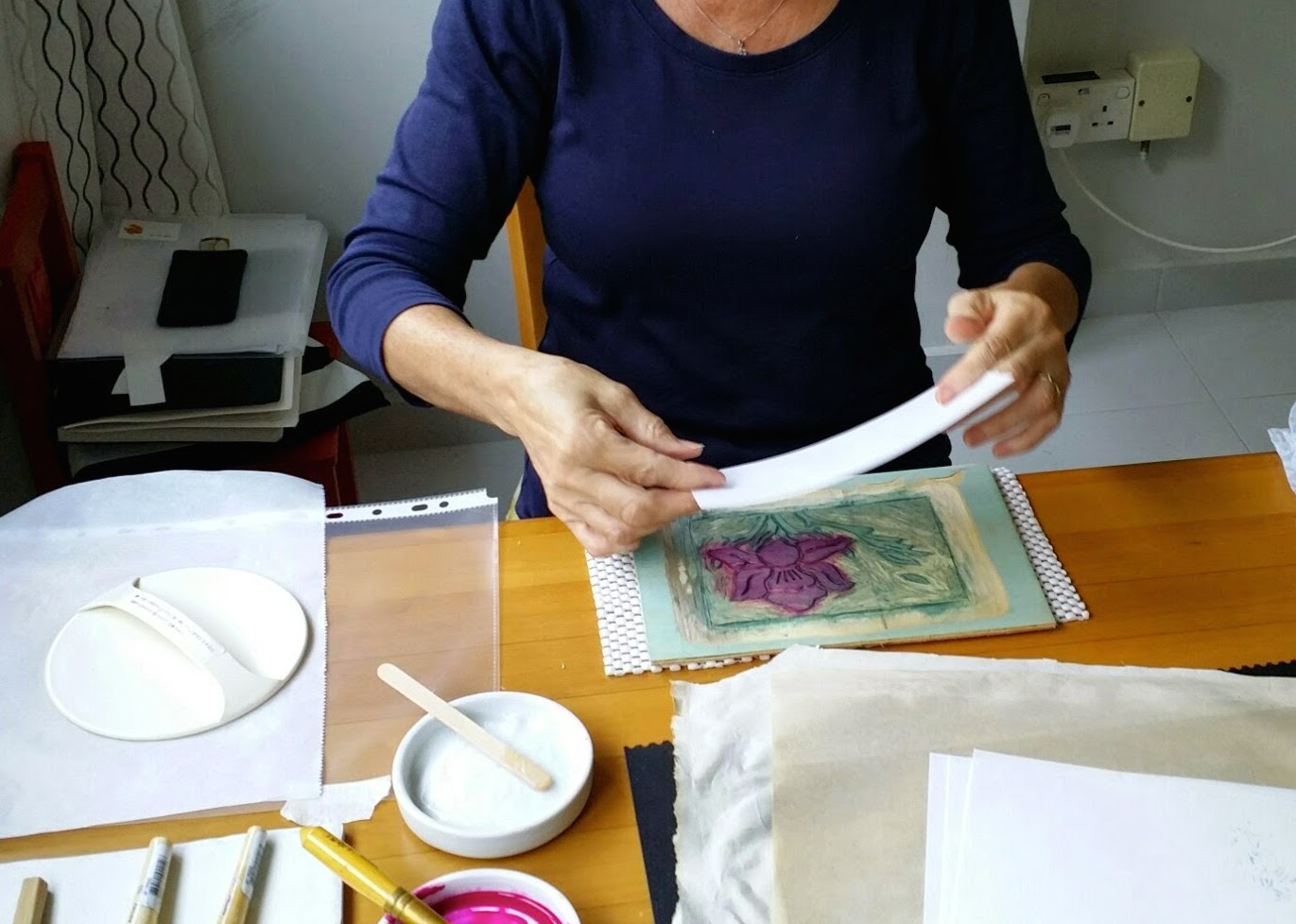 Laying down damp washi paper onto inked block - getting registration accurate not easy!