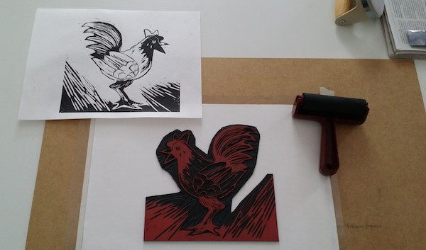 Freshly pulled print and linoblock inking station. No finger prints please - we're professionals! (cough...)