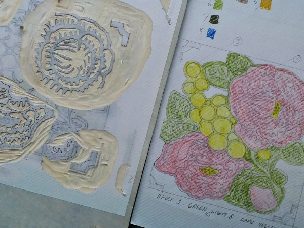 A close-up of my carving before removing the rest of the pasted transfer paper.