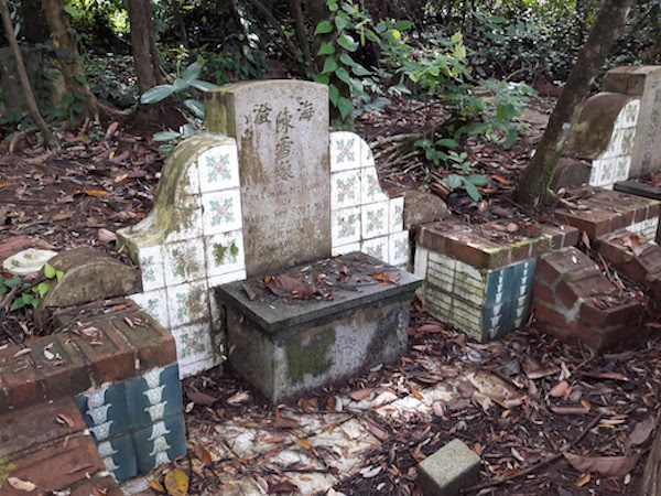 Beautiful collection of tiles both on the gravestone and the surrounding brickwork.