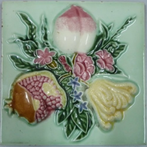 This antique tile was designed with auspicious Chinese motifs of pomegranate, peach and finger citron.