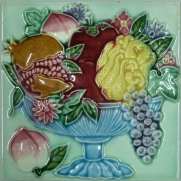 Fruit bowl of peaches, pomegranate, apples, grapes and finger citron.