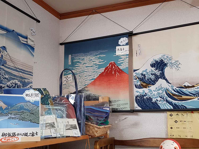 Local gift store with Katsushika Hokkusai's Red Fuji prints on hanging fabric displays