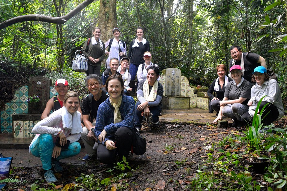 Heritage Tile Tidy Session: Community volunteers in the tropical heat helping to clean up tiles and tombs