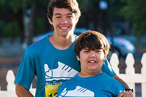 """""""I run to support my sister Isabel, who has epilepsy and is cognitively disabled. She is a patient at Packard Children's and the hospital does so much for her."""" - Robert, top Scamper runner, top Scamper fundraiser, and brother of Isabel, your patient hero for the Children's Fund.  Read their story on our blog ."""