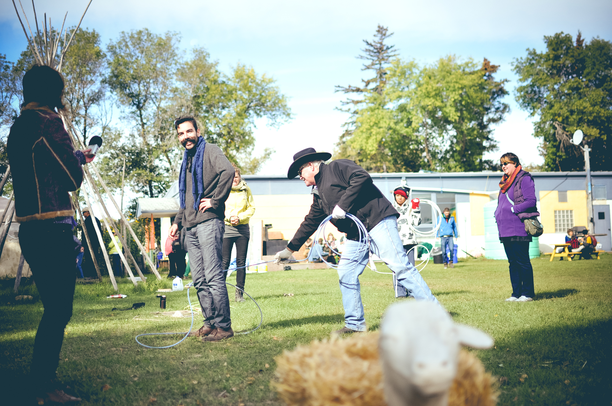 Here's Bill demonstrating how to rope livestock by the feet... err hooves.