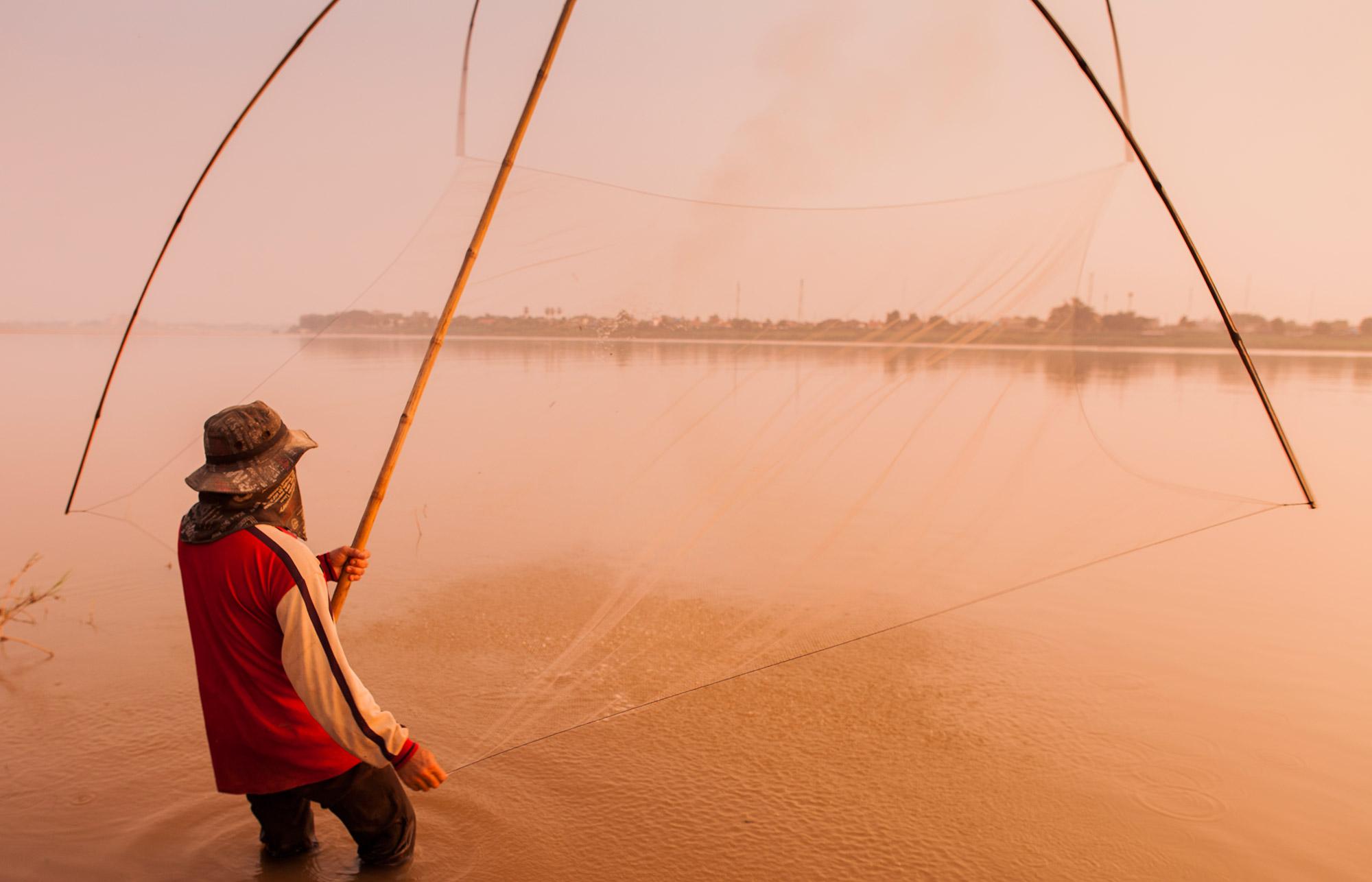 Fisherman on the Mekong in Laos