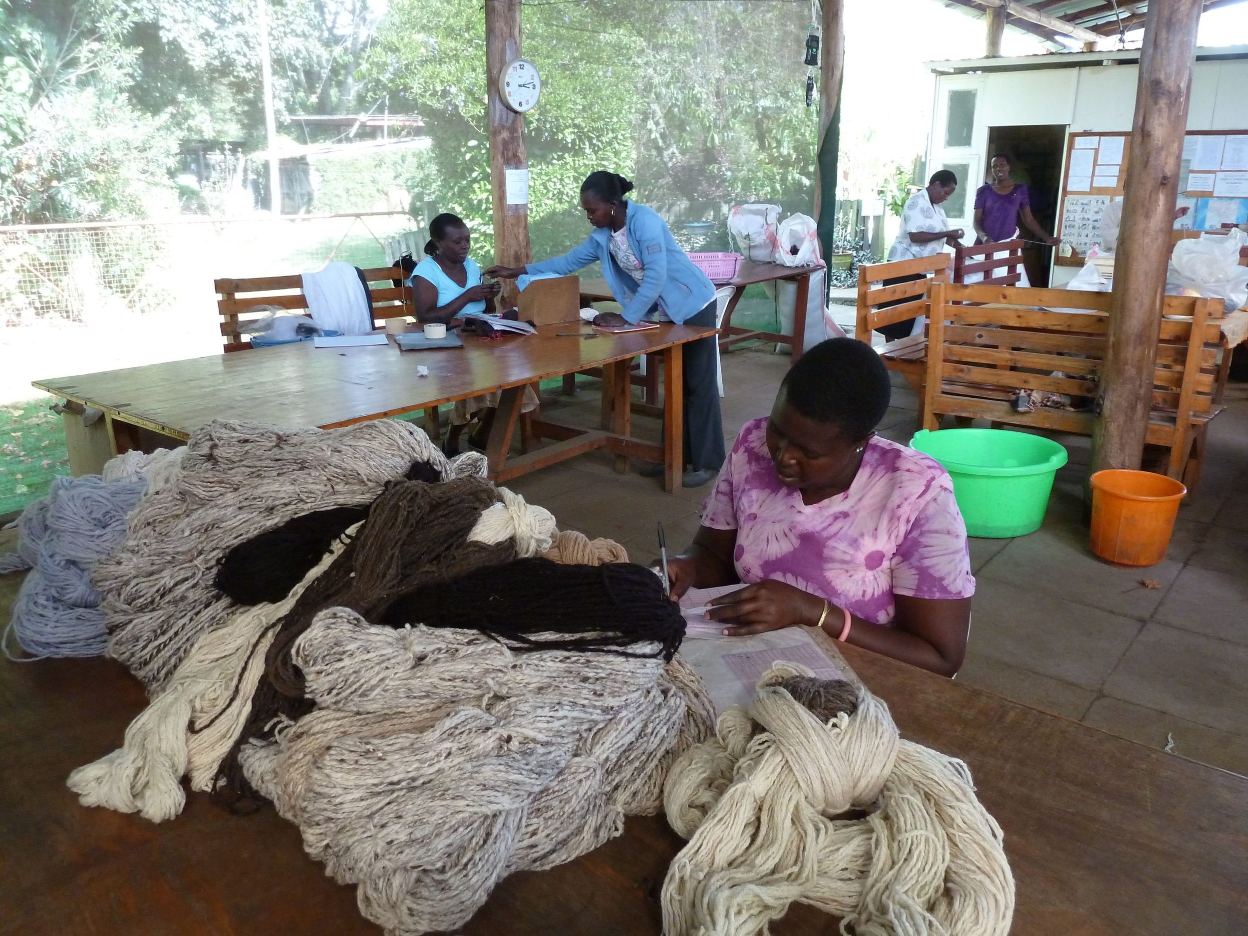 This is Anna working on the allocations of newly spun and dyed wool received when we were there.  In the mid ground Purity and Evelyn are sorting through new knitting work for the knitters.  In the background you can see Monica and Susan doing last minute packing for our order! That order has now safely arrived in Australia and is ready for sale!