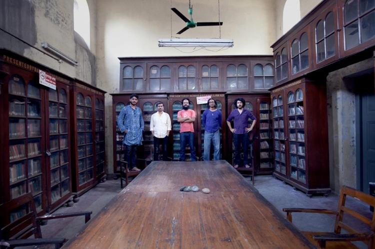 The Chobi Mela team with Salauddin Ahmed at Northbrook Hall Library.