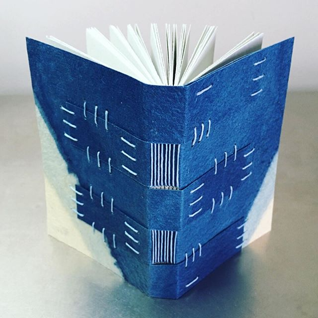 I've been having a blast teaching my Miniature Exposed-Spine Bindings class at @watkinscommunityeducation this semester. So far, students have made five variations of the longstitch binding, and tonight we're moving on to the crossed-structure binding (shown here). . . . . . #watkinscollege #watkinscommunityeducation #nashville #nashvilletn #madeintennessee #handmadeinnashville #nashvilleartist #nashvillearts #bookarts #bookartist #paperarts #handmadebook #bookbinder #bookbinding #booklover #artclass #bookbindingclass #teachingartist #communityeducation #bookspines #bookspinebeauty #exposedspinebinding #crossedstructurebinding #waxedlinenthread #cavepaper #carveouttimeforart #creativelifehappylife #creativeprocess #livecolorfully #indigodye