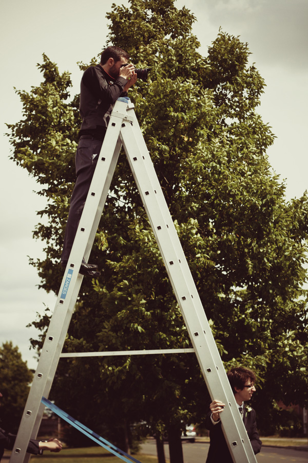 Scaling a shaky ladder to get the shot.