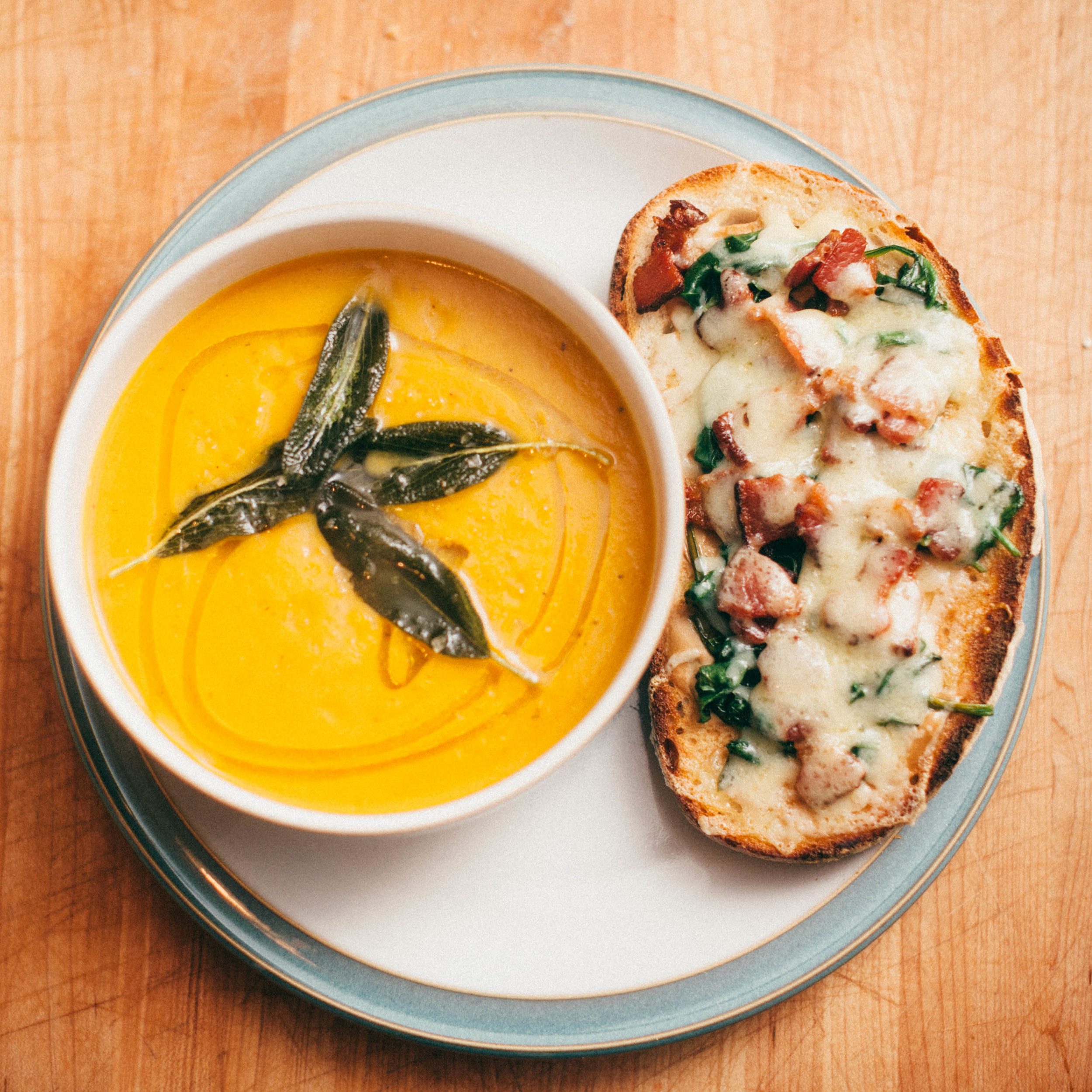 Butternut squash soup with fried sage & Spinach and bacon tartine