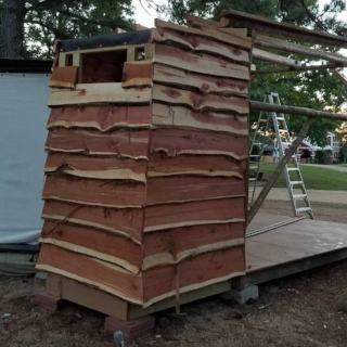 The siding going up... not easy to do with boards that are not straight/square.