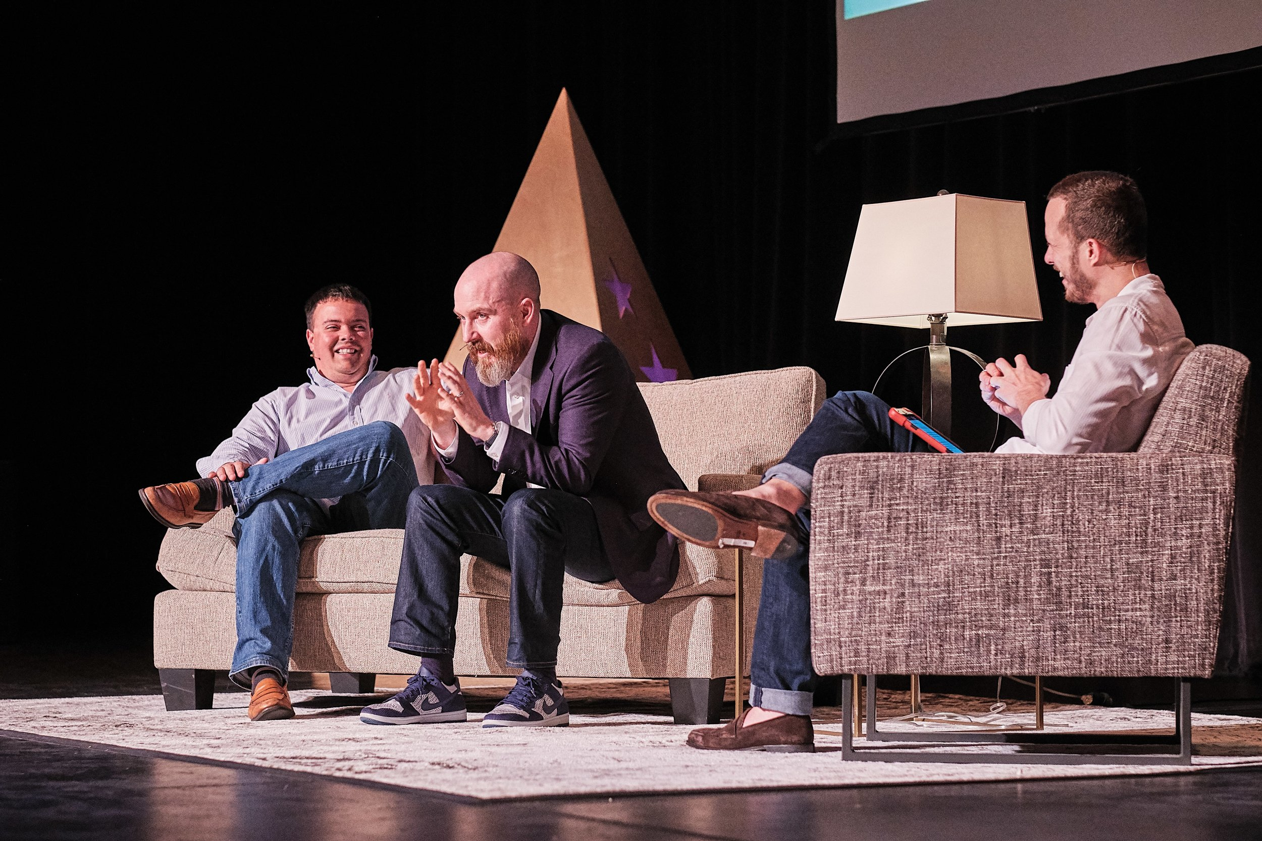 Brent on stage with Sam Hinke and Patrick O'Shaughnessy at Capital Camp.