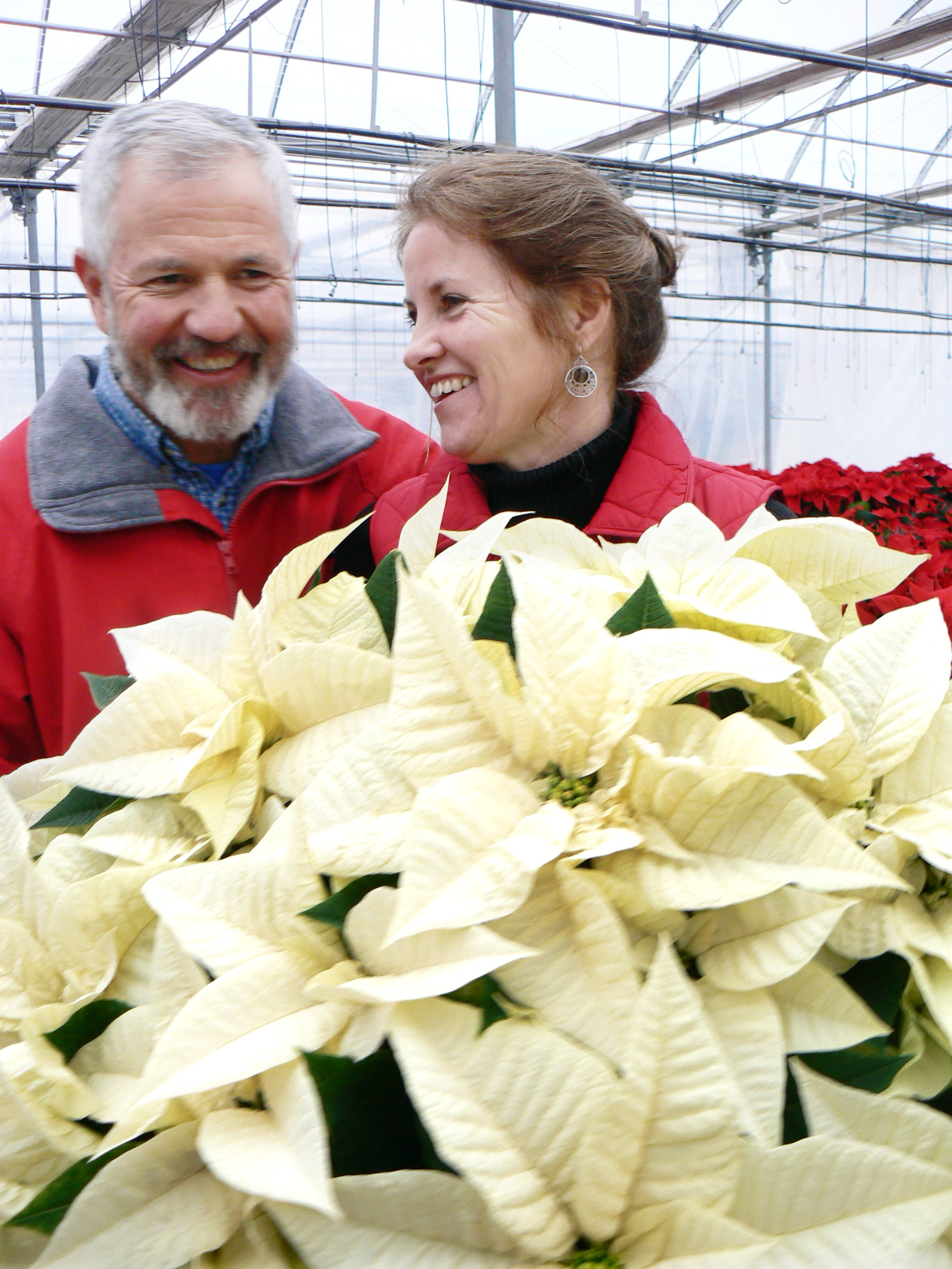 Owners Tim and Linda Kirby spend some time in the greenhouse together.