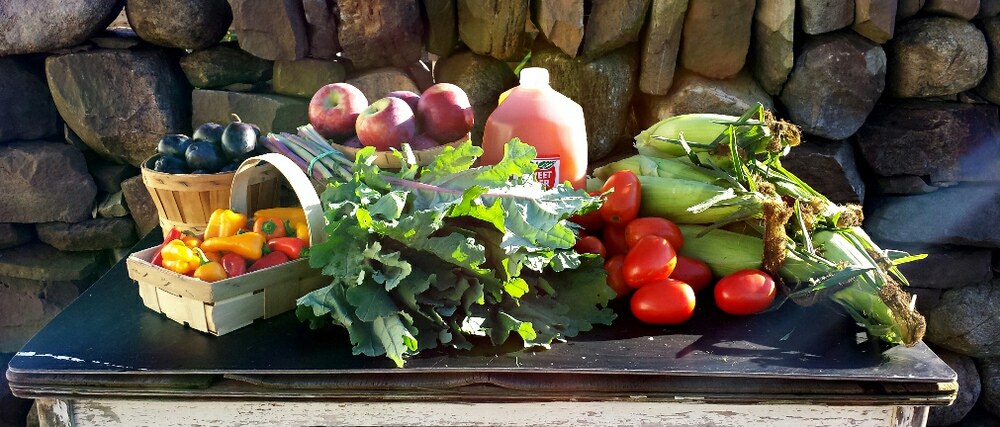 A Full share of produce from the month of August.