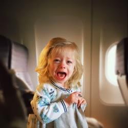 girl-crying-on-plane.jpg
