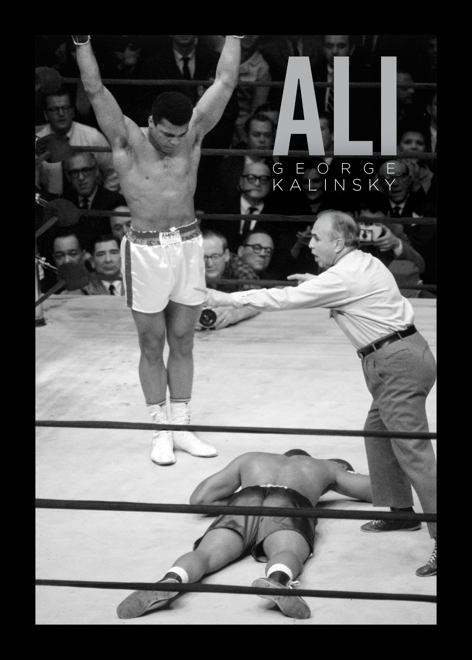 "ALI: Behind the Lens with an American Legend . 28 pages 10""x14"" softcover. Published on the occasion of the exhibition "" I am the King of the World"": Photographs of Muhammed Ali  by George Kalinsky at the New-York Historical Society"