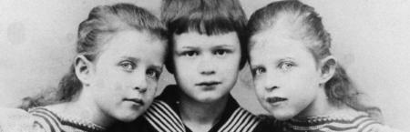 Max Planck's twin daughters Emma and Grete flank his eldest son Karl. Courtesy Archiv der Max-Planck-Gesellschaft, Berlin-Dahlem.