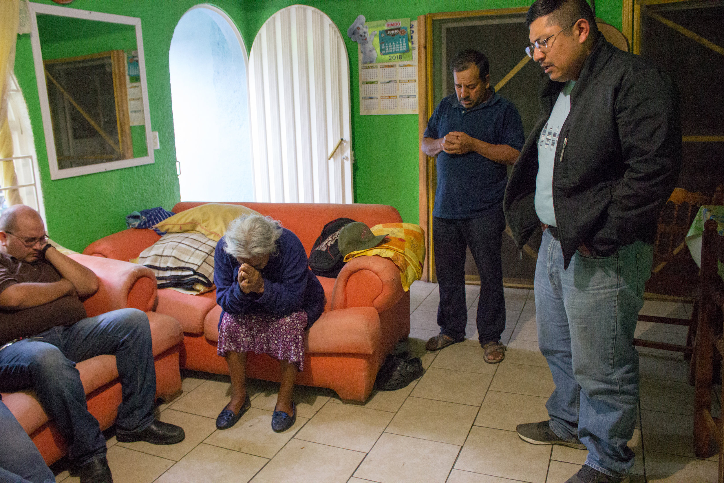 Not long after landing in Oaxaca City on June 25, we drove to the home of Junior's relatives. His aunt was in the hospital throughout our visit. Here, the family prays before Junior's uncle takes food to the hospital for the staff there.