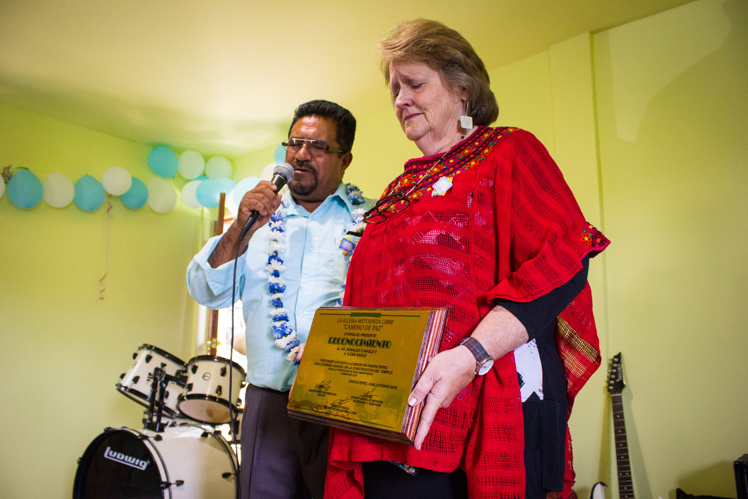 Ilene is overwhelmed when Senen and the other pastors present her with a plaque of gratitude. It is no small feat for them to honor her in this way, in a village where items like this are not made locally.