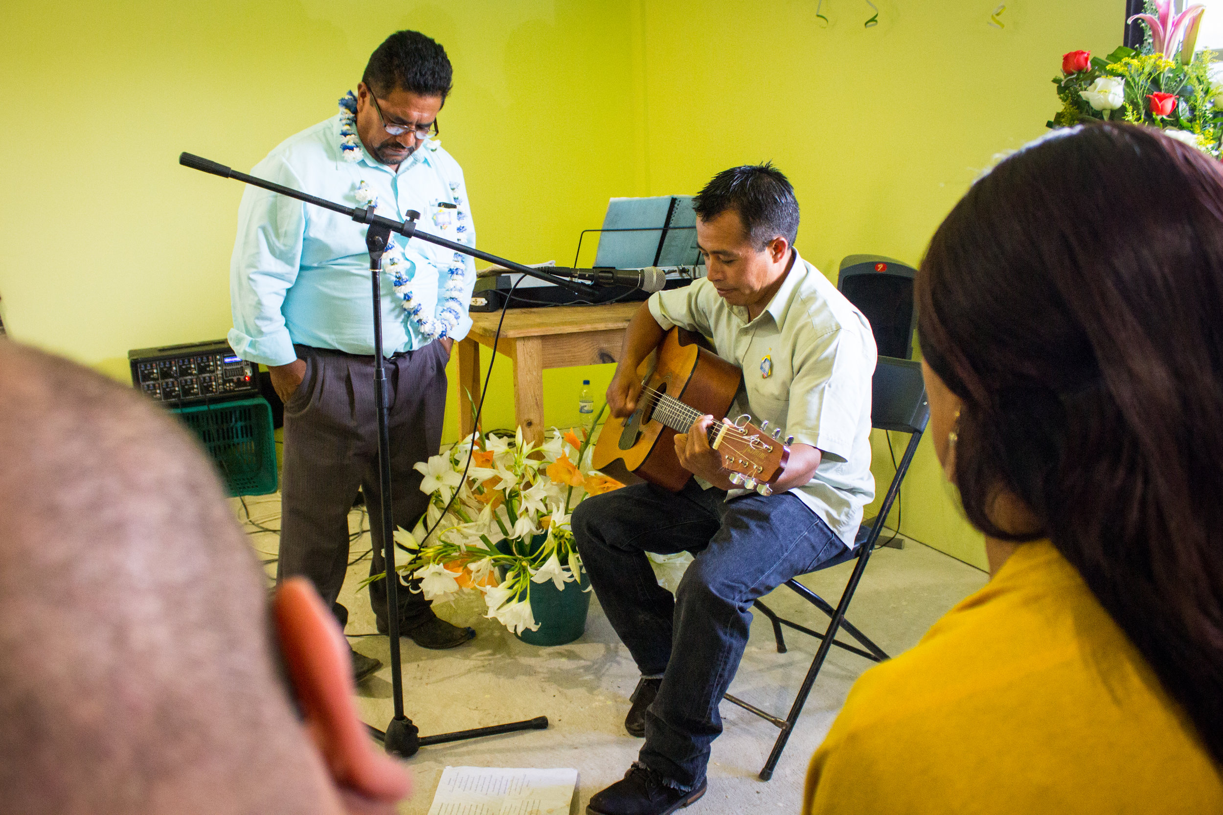 Senen and a church member sing at the end of the service.