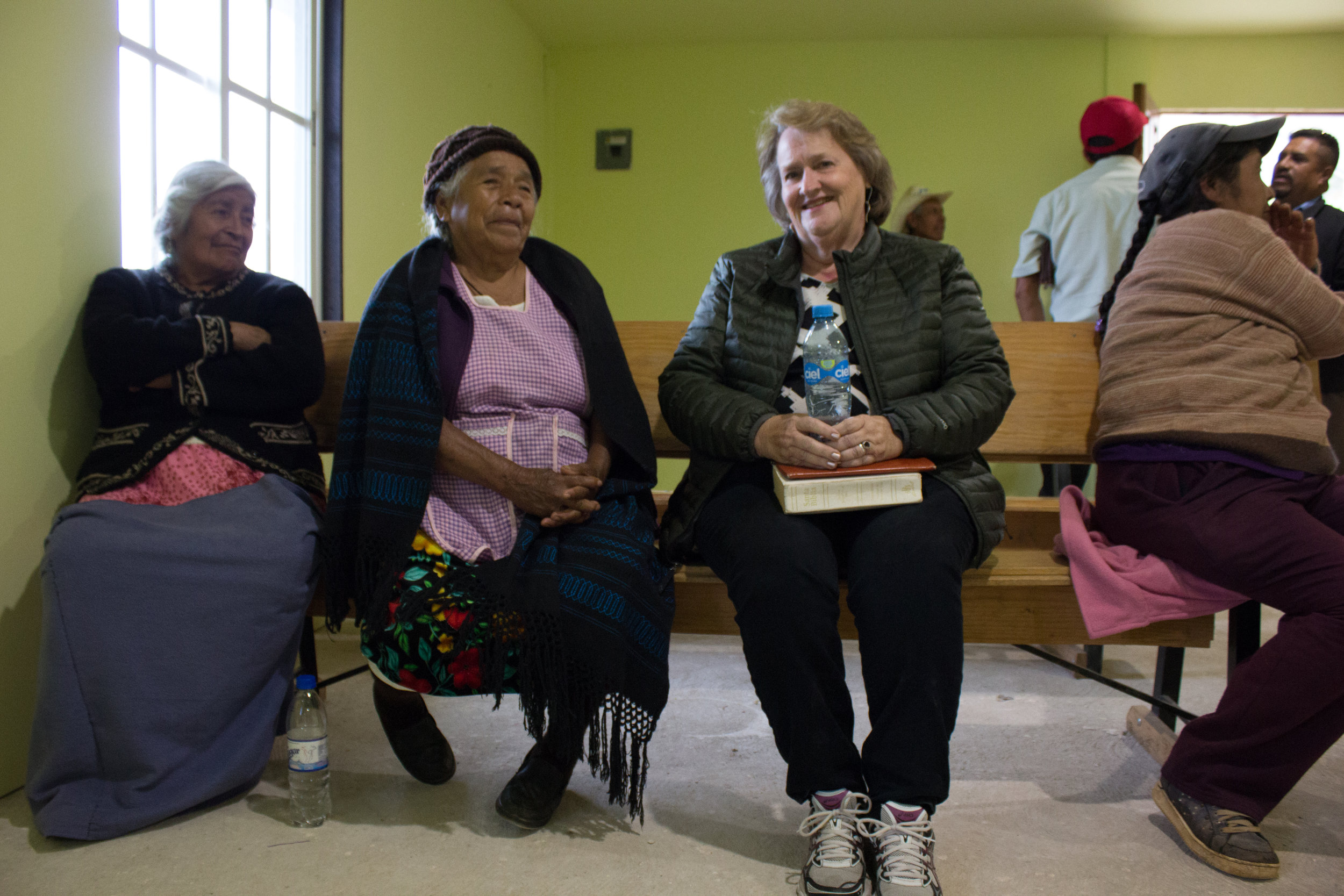 Ilene brings medicine and other items on her trips. She has met many people over the years, such as these women, and is familiar with their needs.