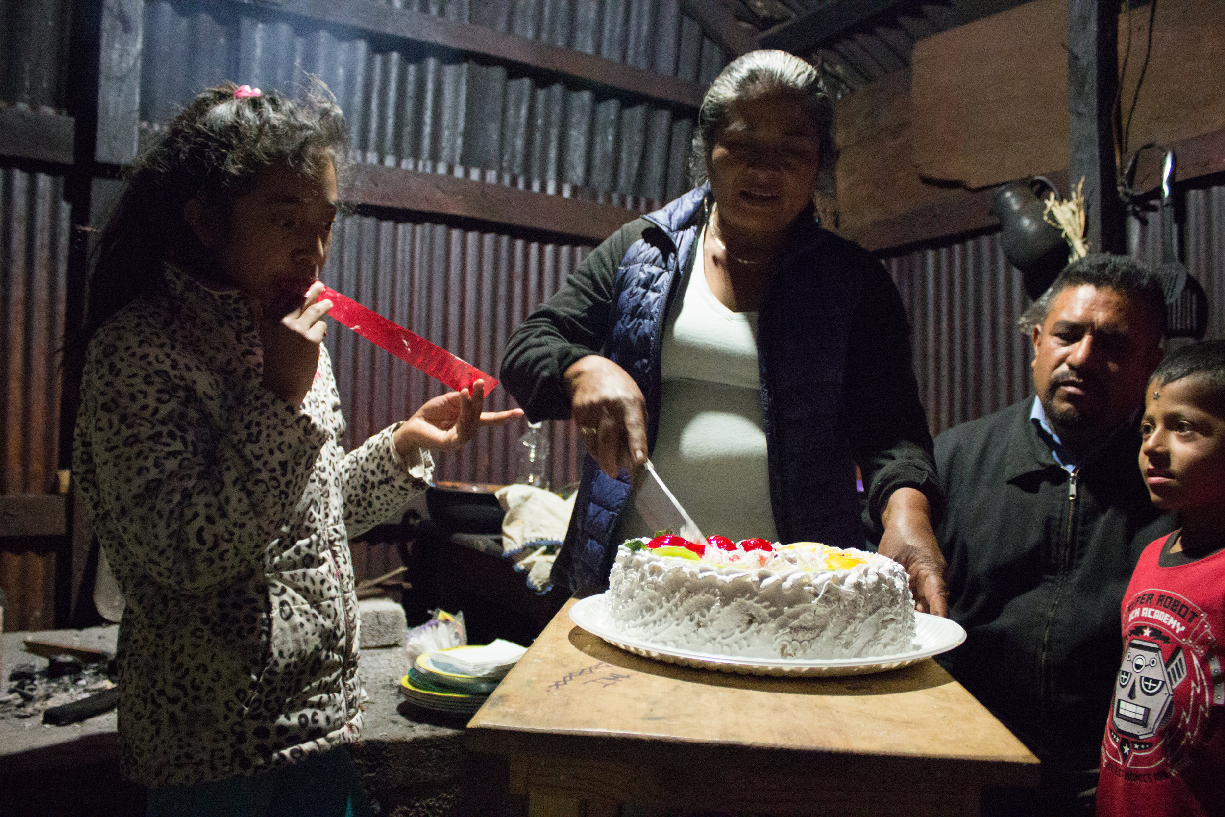 A birthday cake is served in Bernardita's kitchen for one of her daughters. It's our last night in Chapultepec.
