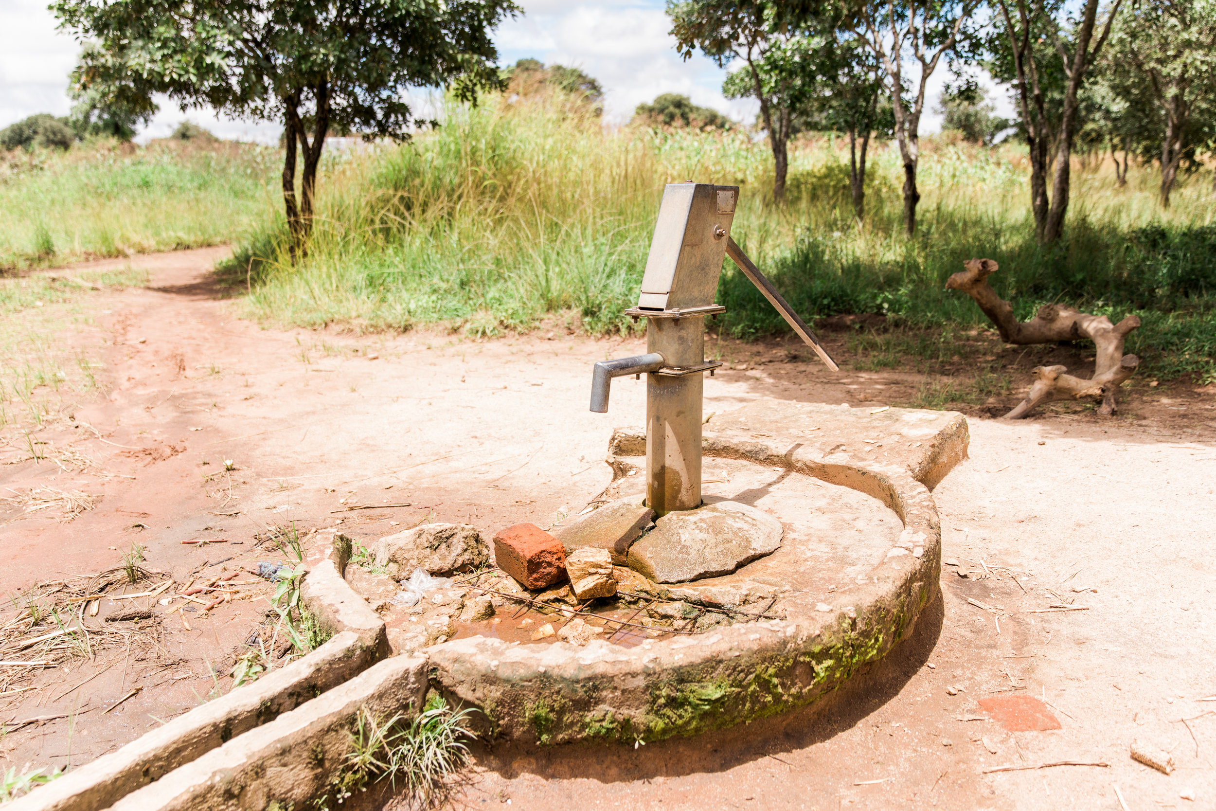 Here we have the bore hole where Kate gets her water.  This was repaired recently and isn't too far from Kate's house.  Previously she had to walk a mile or two to go get her water so the repair of this bore hole was huge!