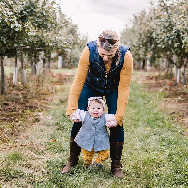 Reliving one of my favorite days from this fall. 😍  The day she turned 7 months old we took her to an orchard and had one of the best Sunday Fundays ever. I see a little tradition starting here and I'm so excited about it. 💜  Next year she will be walking through the orchard without holding on.... 😭 (But I hope she chooses to hold our hands anyway) 🤗 . . . . . . . . . . . #fallactivities #mymotherhood #thisisme #thisismotherhood #momlife #mommyandme #pickingapples #appleofmyeye #girlmom #7monthsold #ourbabygirl #momtogs #mompreneur