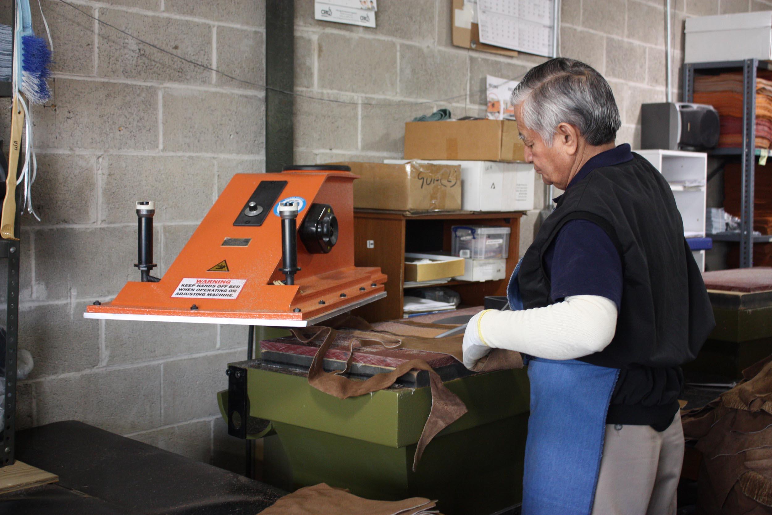 Diecutting fabric on a heavy duty press.