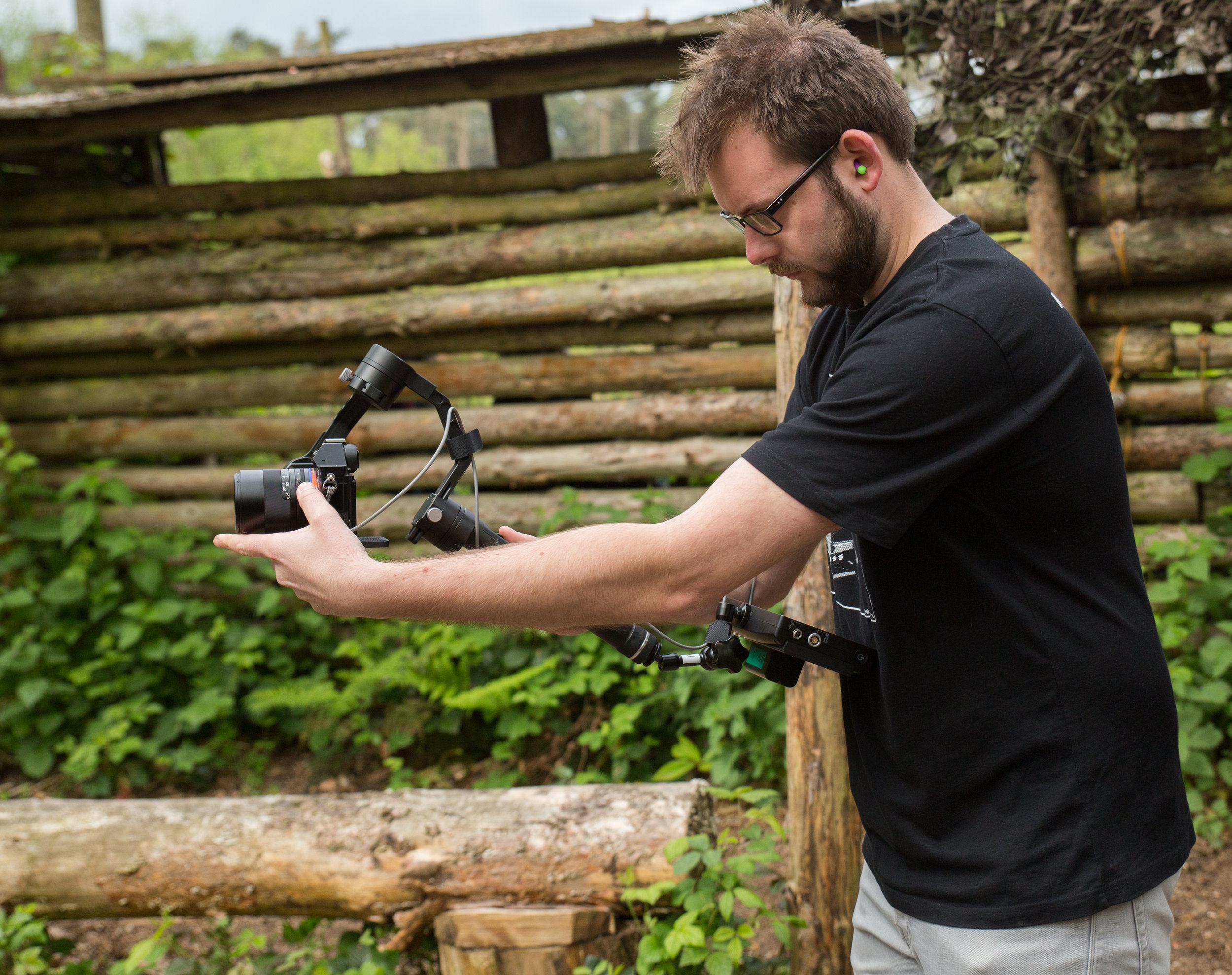 Adam Plowden framing and focusing on the Zhiyun Crane, Sony a7S, ZEISS Loxia 2.8/21 prime lens, Atomos Shogun