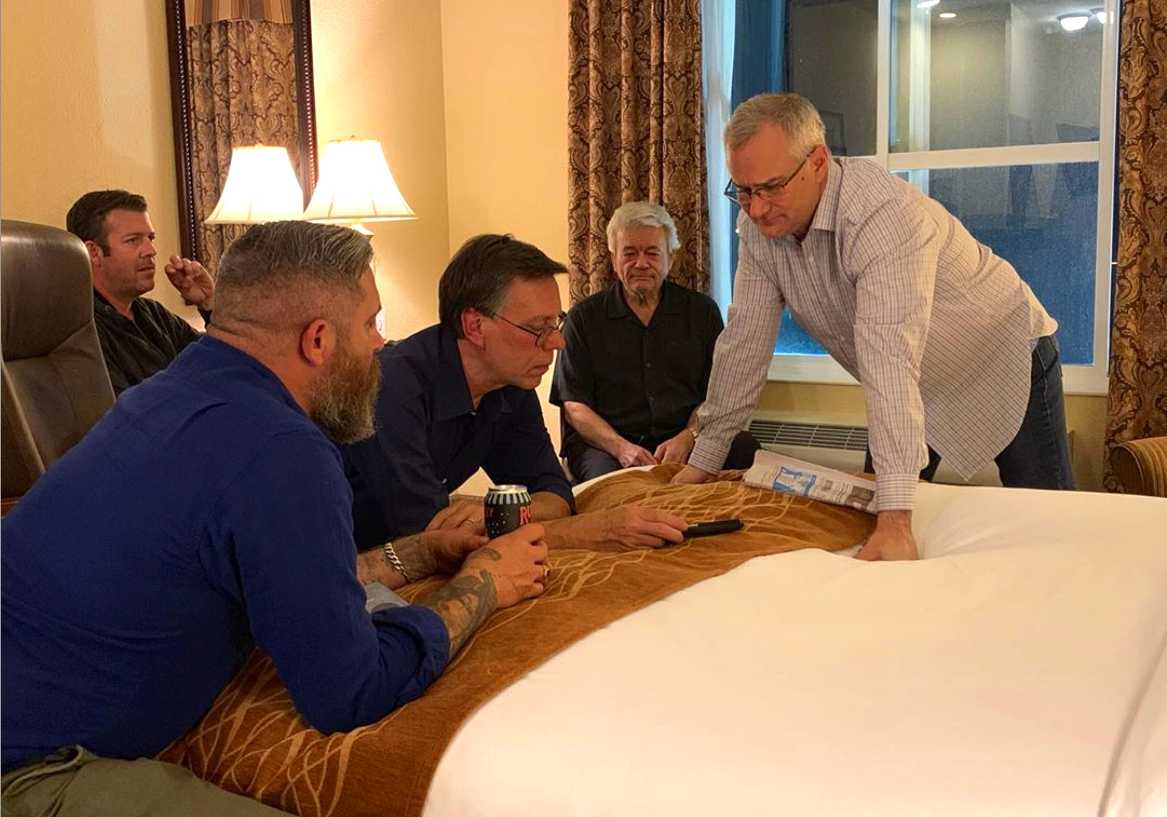 Reviewing UFO info with Bob Lazar and F-18 fighter pilot Commander Fravor at our hotel in McMinnville, Oregon.