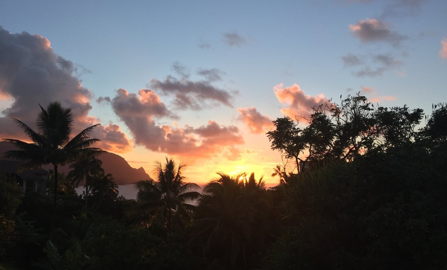Sunset from Hanalei Bay Resort. The small peak seen through the trees on the left is Makana, or Bali Hai, made famous by South Pacific.
