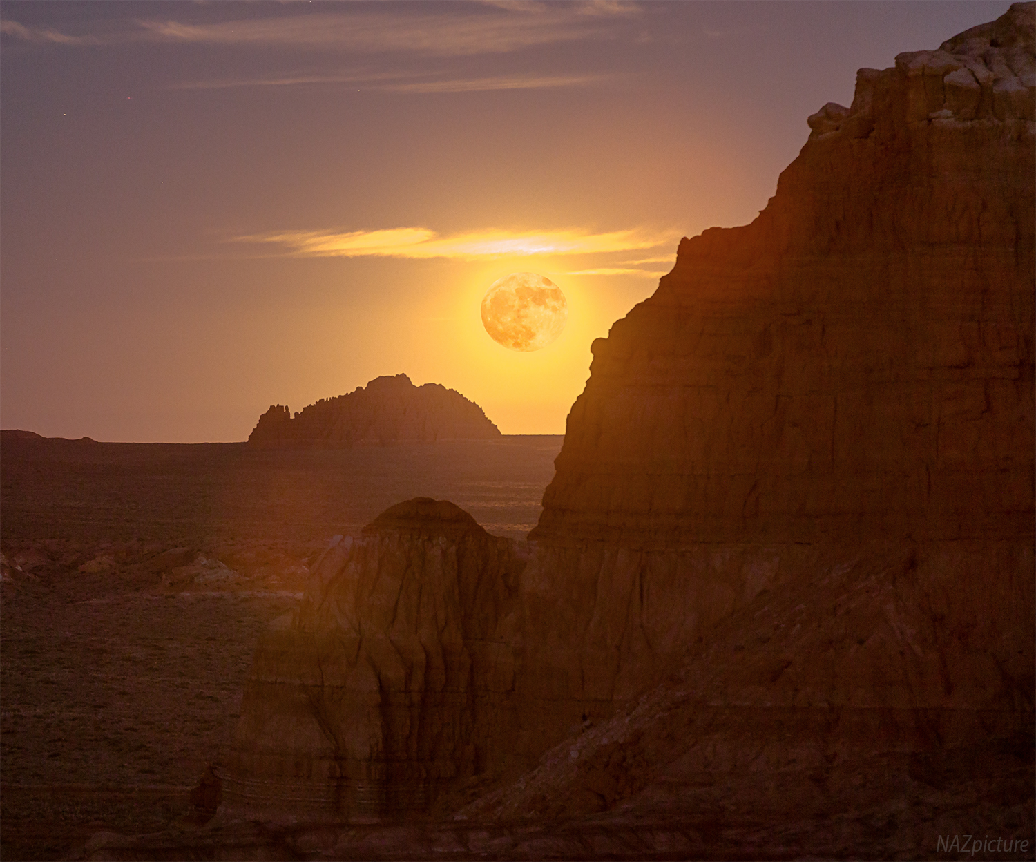 Supermoon rising over Goblin Valley State Park.