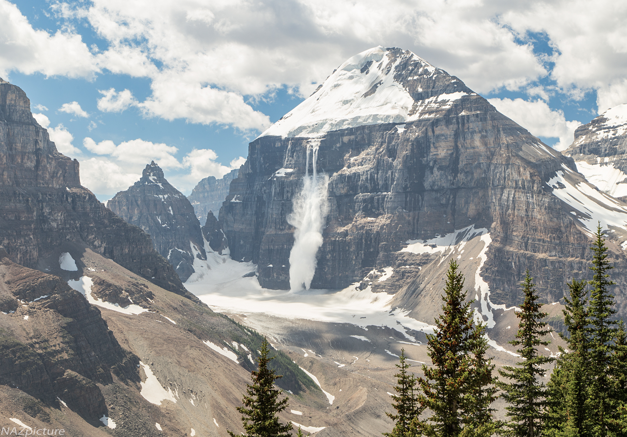 An avalanche cascades off the face of Mt. Lefroy. [Banff National Park, Alberta]