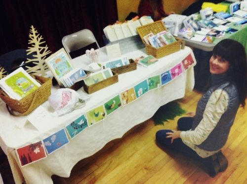 Here's a pic of me setting up. I had fun figuring out how to make a nice display of my products.