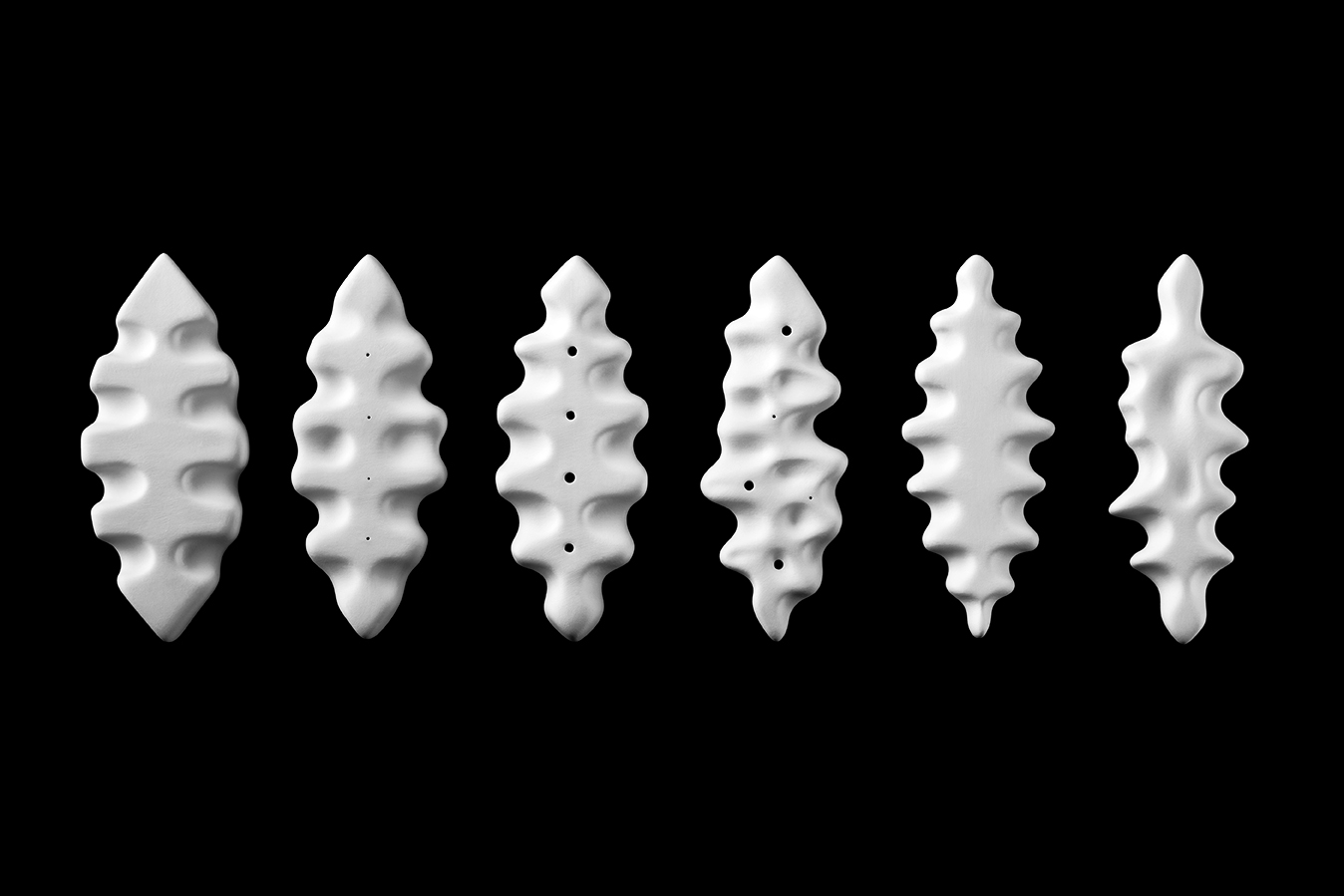 LEAF INTUIGRAMS .  2014. Porcelain. (approx)   8 x 3 x 1/2 in, each