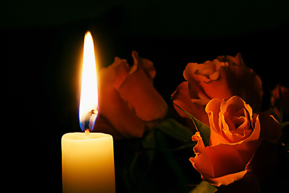 Candle and roses